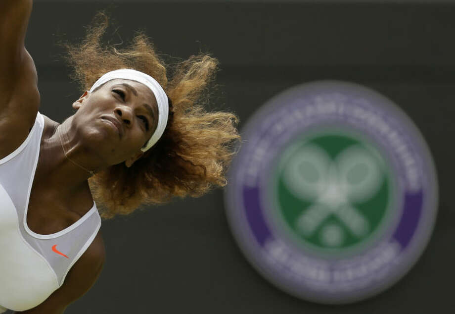 ADVANCE FOR WEEKEND EDITIONS, JUNE 21-22 - FILE - In this June 27, 2013, file photo, Serena Williams, of the United States, serves to Caroline Garcia, of France, during their women's second-round singles match at the All England Lawn Tennis Championships in Wimbledon, London. Williams is ranked No. 1 and seeded No. 1 at Wimbledon, where she has won the title five times. (AP Photo/Alastair Grant, File)