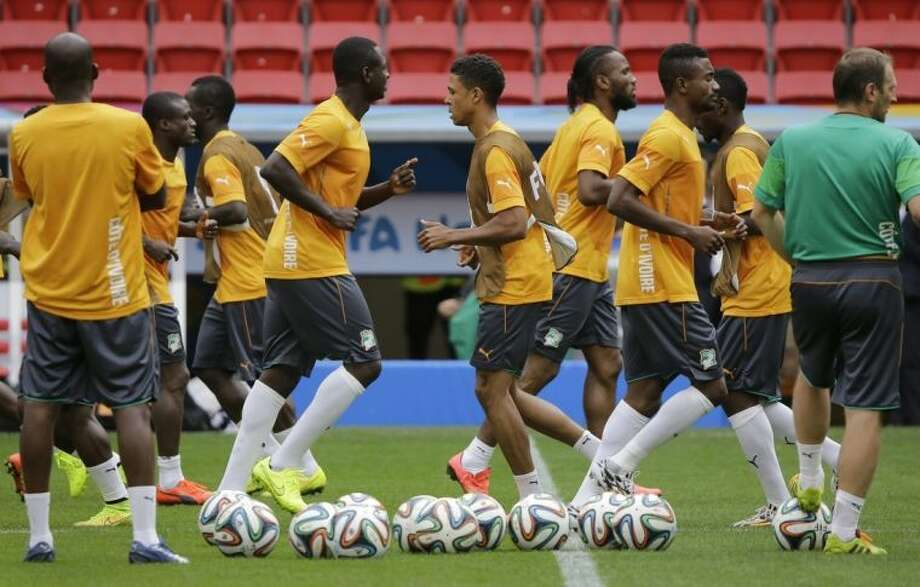 Ivory Coast soccer players practice drills during a training session at the Estadio Nacional in Brasilia, Brazil, Wednesday, June 18, 2014. Ivory Coast plays in group C of the 2014 Brazil soccer World Cup. (AP Photo/Sergei Grits)