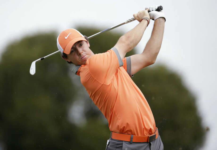 """FILE - In this Thursday, Feb. 27, 2014 file photo, Rory McIlroy of Northern Ireland tees off on the fifth hole during the first round of the Honda Classic golf tournament, in Palm Beach Gardens, Fla. Rory McIlroy has decided to play for Ireland, not Britain, at the 2016 Olympics in Rio de Janeiro. The 25-year-old McIlroy, who is from Northern Ireland, was eligible to play for Britain or Ireland and had been wrangling over a decision for more than a year. The two-time major winner says Wednesday, June 18, 2014 """"I have been thinking about the decision a lot and remembered all the times I represented Ireland as an amateur.""""(AP Photo/Lynne Sladky, File)"""