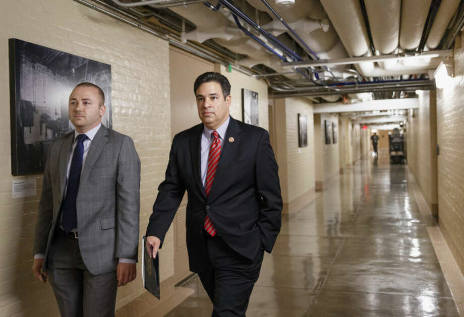 Rep. Raul Labrador, R-Idaho, walks through a basement corridor on Capitol Hill in Washington, Wednesday, June 18, 2014, to a meeting of the House Republican Conference where he and other candidates vying for House GOP leadership posts make their pitches to the rank-and-file in the tumultuous aftermath of House Majority Leader Eric Cantor's sudden loss last week in his Virginia primary race. Labrador is considered a longshot to take Cantor's place but House Majority Whip Kevin McCarthy, R-Calif., is the strong favorite to become the new majority leader, an intense intramural clash has emerged for the whip post between Rep. Scalise, who runs a conservative faction of lawmakers in the Republican Study Committee, and Chief Deputy Whip Peter Roskam, R-Ill., and Rep. Marlin Stutzman, R-Ind. (AP Photo/J. Scott Applewhite)