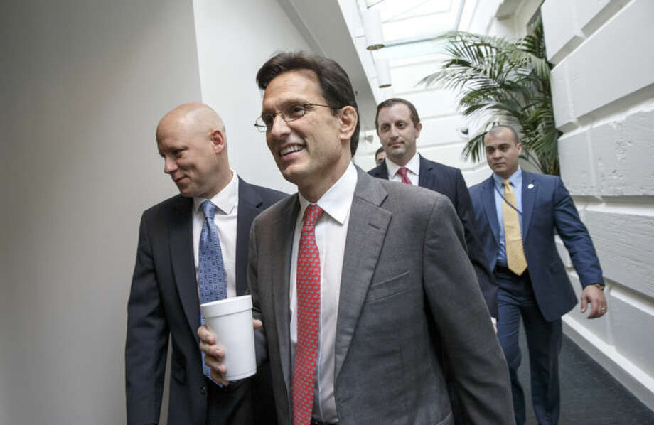 Outgoing House Majority Leader Eric Cantor of Va., arrives for a Republican Conference meeting on Capitol Hill in Washington, Wednesday, June 18, 2014, as candidates for House GOP leadership posts make their pitches to the rank-and-file in the tumultuous aftermath of Cantor's sudden loss last week in his Virginia primary race. Rep. Kevin McCarthy of California, is the strong favorite to become the new majority leader, if he staves off a longshot challenge from conservative Rep. Raul Labrador of Idaho. (AP Photo/J. Scott Applewhite)