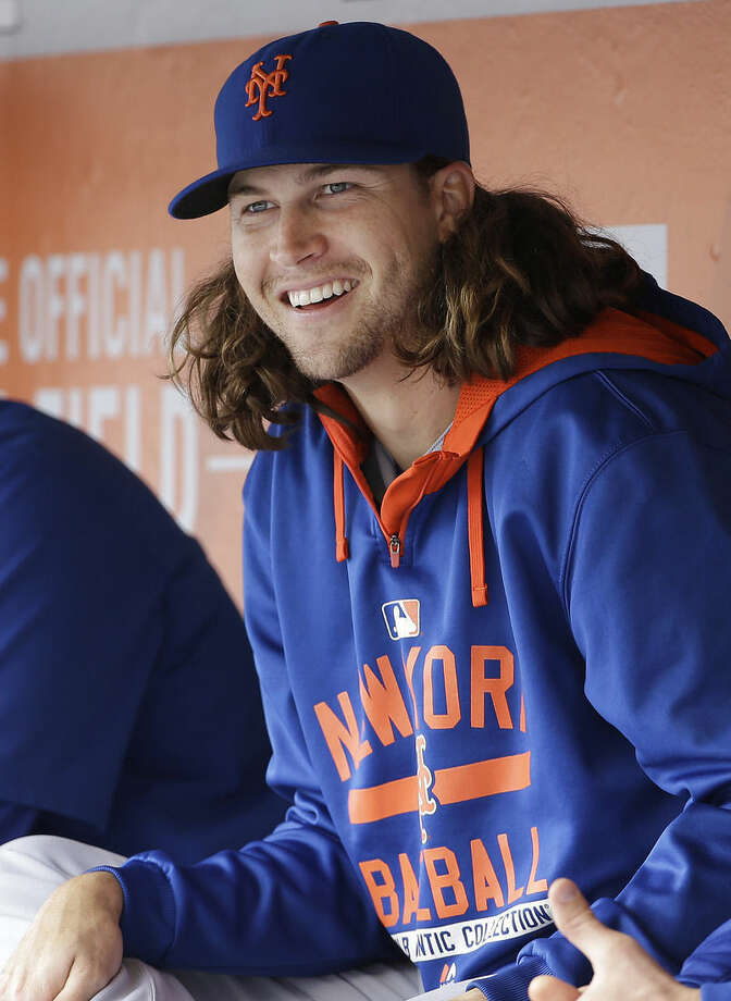 New York Mets pitcher Jacob deGrom smiles in the dugout during the ninth inning of a baseball game against the San Francisco Giants in San Francisco, Wednesday, July 8, 2015. The Mets won 4-1. (AP Photo/Jeff Chiu)