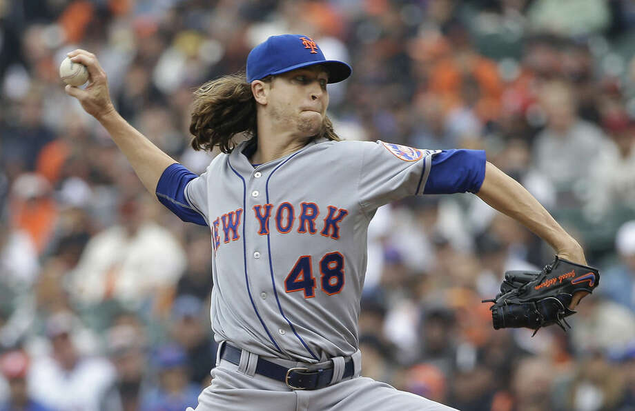 New York Mets pitcher Jacob deGrom (48) throws against the San Francisco Giants during the first inning of a baseball game in San Francisco, Wednesday, July 8, 2015. (AP Photo/Jeff Chiu)