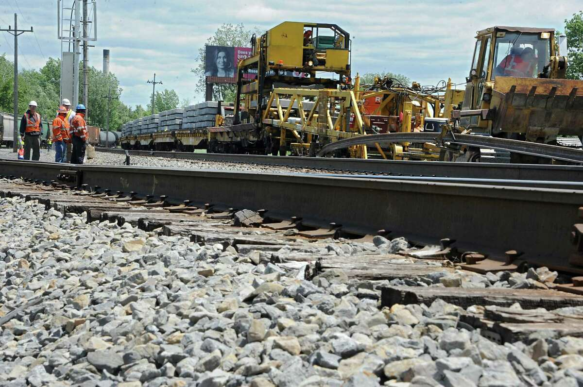 Employees from Harsco Tack Technologies work on a second rail between Albany and Schenectady near West Albany Pocket Park on Thursday, June 9, 2016 in Colonie, N.Y. Here they are dropping concrete ties onto a road bed and threading and clipping rail onto the concrete ties. (Lori Van Buren / Times Union)
