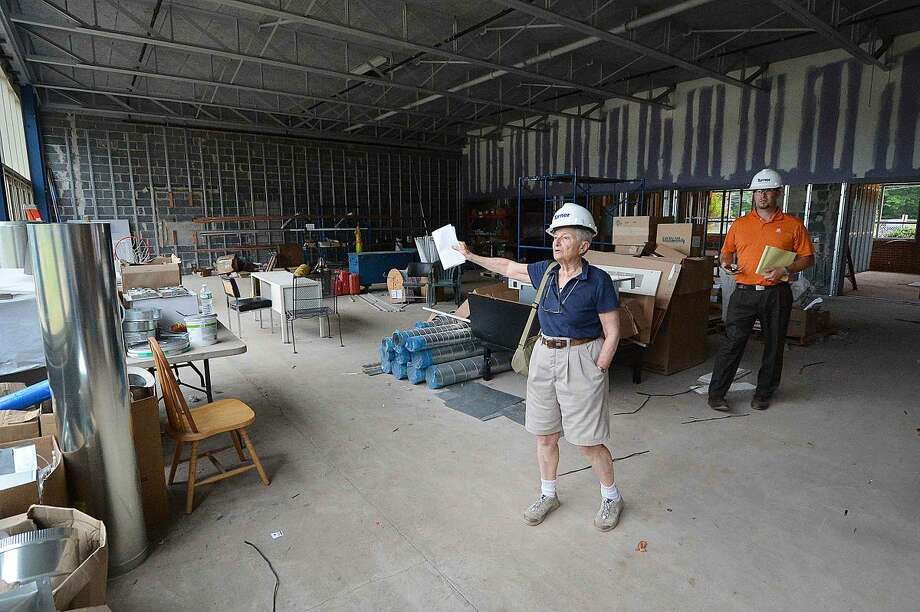 Judy Zucker looks over the gymnasium at Comstock Community Center with Turner Construction's Stephen Giametta.