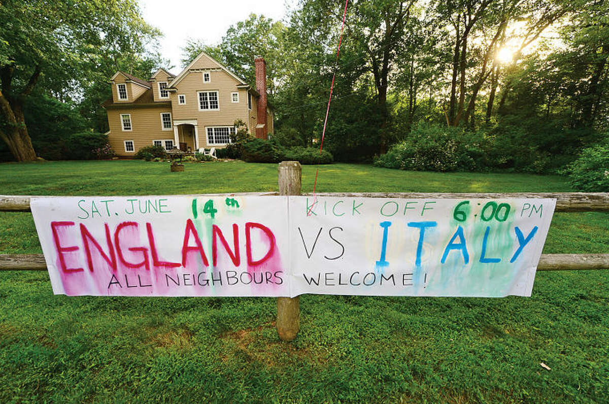 Wilton resident and World Cup fan Nick Slater hosts a World Cup viewing party with friends and neighbors. Here, Slater cheers on his favorite team England as they face off against Italy during an early round match.