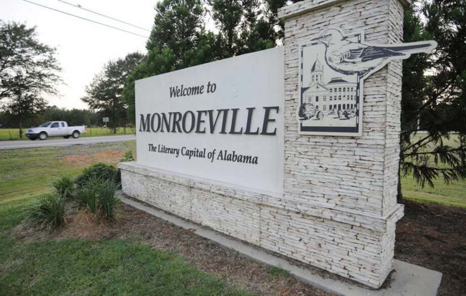 """This photo taken on Wednesday, July 8, 2015, shows a truck passing a sign decorated with a mockingbird in Monroeville, Ala., the hometown of """"To Kill a Mockingbird"""" author Harper Lee. Lee's second book """"Go Set a Watchman"""" is set for release July 14, 2015, and the town includes sites featured in both novels. (AP Photo/Jay Reeves)"""