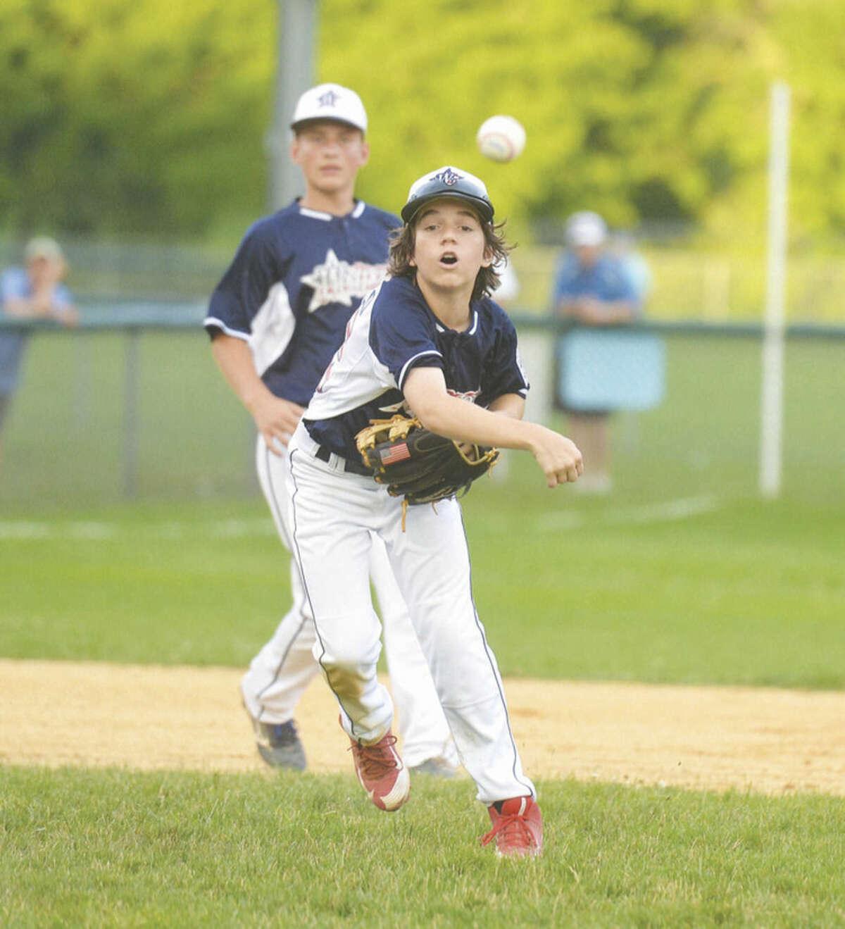 Hour photo/Alex von Kleydorff Westport's Josh DeDomenico throws to first base against Trumbull National on Wednesday.