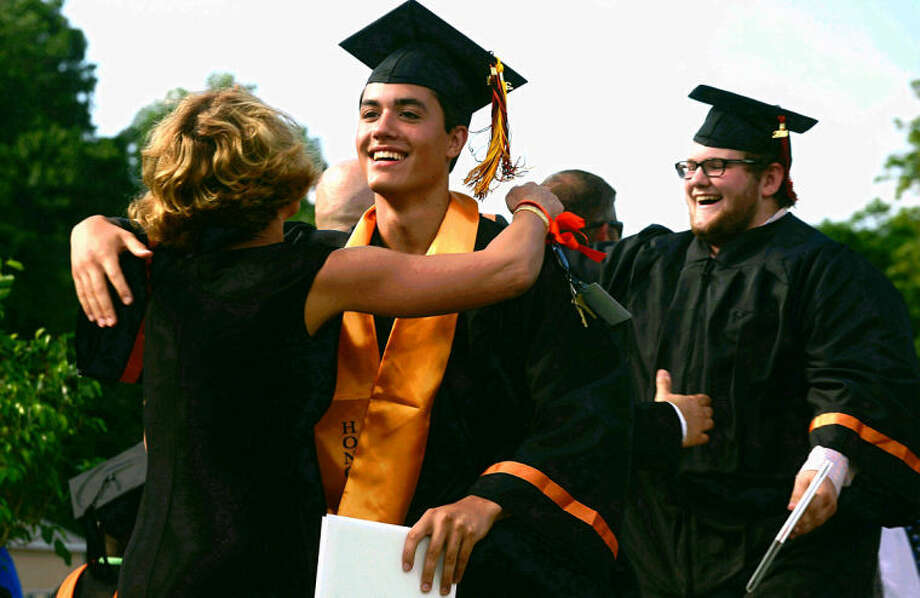 Hour photo / Erik Trautmann Michael Hoherchak graduates from Stamford High School Thursday afternoon.