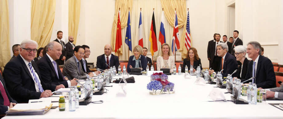 German Foreign Minister Frank Walter Steinmeier, left, French Foreign Minister Laurent Fabius, 2nd left, European Union High Representative for Foreign Affairs and Security Policy Federica Mogherini, 5th right,, U.S. Secretary of State John Kerry, 3rd right and British Foreign Secretary Philip Hammond, right, meet along with representatives from China and Russia at an hotel in Vienna, Thursday, July 9, 2015. Negotiations over Iran's nuclear program lurched toward another deadline on Thursday with diplomats reconvening amid persistent uncertainty and vague but seemingly hopeful pronouncements from participants. (Carlos Barria/Pool Photo via AP)