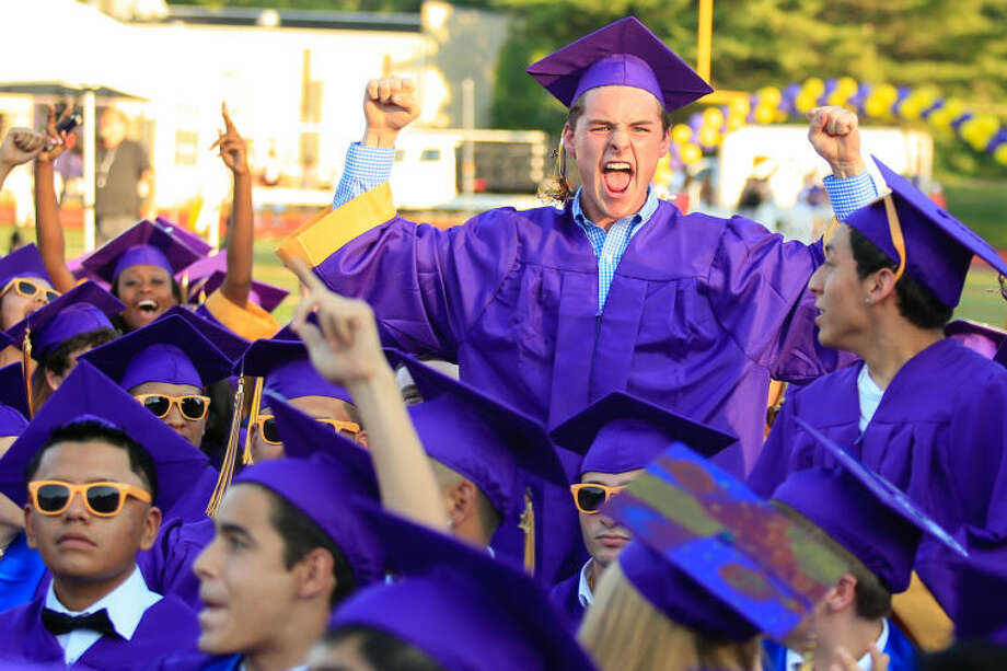 Hour Photo/Chris Palermo. Colin Morgan celebrates during the Westhill High School class of 2014 commencement ceremonies Thursday evening.