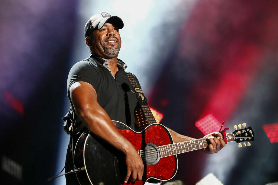 FILE - In this June 14, 2015 file photo, Darius Rucker performs at the CMA Music Festival in Nashville, Tenn. Mainstream country music has been quietly distancing itself from the Confederate flag for years, but as the debate reignites following a massacre at a black church in South Carolina on June 17, country artists still struggle to articulate their feelings about the flag's history and symbolism. (Photo by Al Wagner/Invision/AP, File)