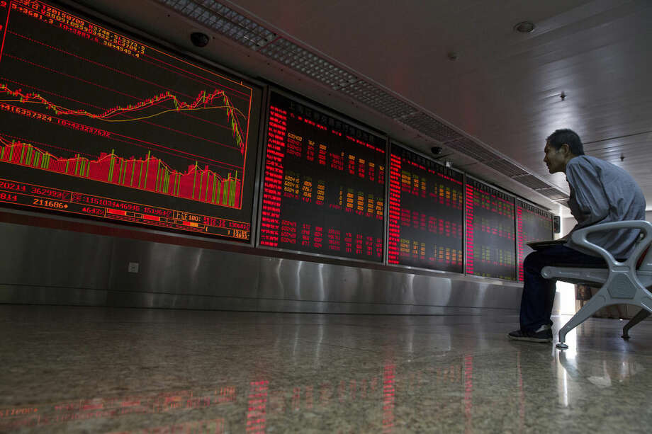 A Chinese investor monitors stock prices at a brokerage house in Beijing, Thursday, July 9, 2015. Asian stock markets continued to react on Thursday as the Chinese government took measures aimed at stabilizing the market. (AP Photo/Ng Han Guan)