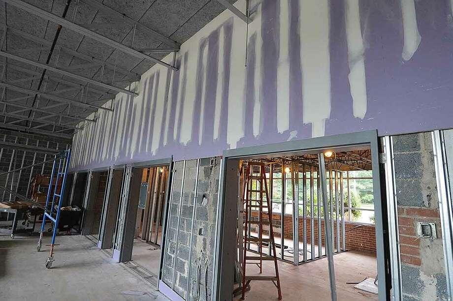 Hour Photo/Alex von Kleydorff Construction well under way at Comstock Community Center in Wilton