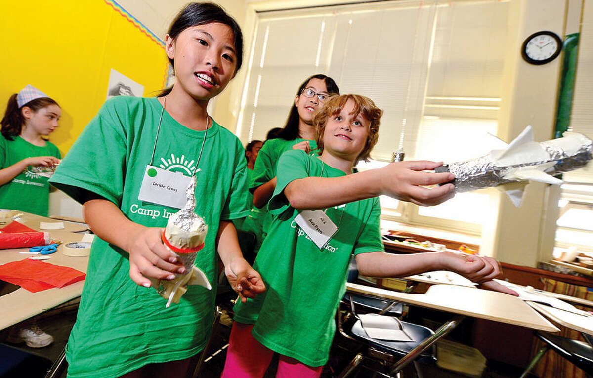 Hour photo / Erik Trautmann Jackie Cross and Ava Ryen get ready to launch their handmade rockets as Amazing Girls Science hosts a Camp Invention workshop for girls in grades 1 to 6 Thursday at Nathan Hale Middle School.