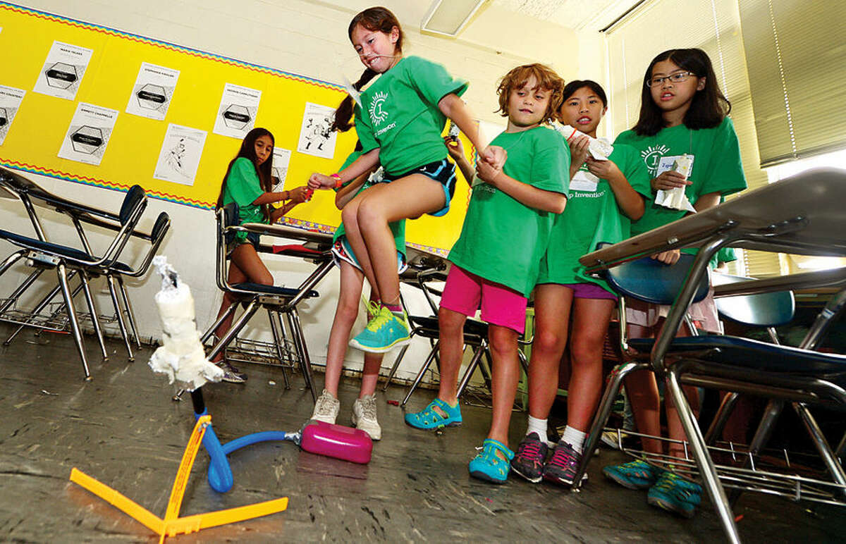 Hour photo / Erik Trautmann Miranda Silva-Meza launches a handmade rocket as Amazing Girls Science hosts a Camp Invention workshop for girls in grades 1 to 6 Thursday at Nathan Hale Middle School.