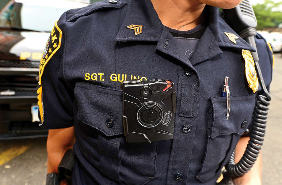 Hour photo / Erik Trautmann Norwalk police seargent Sophia Gulino wears a body camera during patrol Thursday as the department begins a training with the devices.