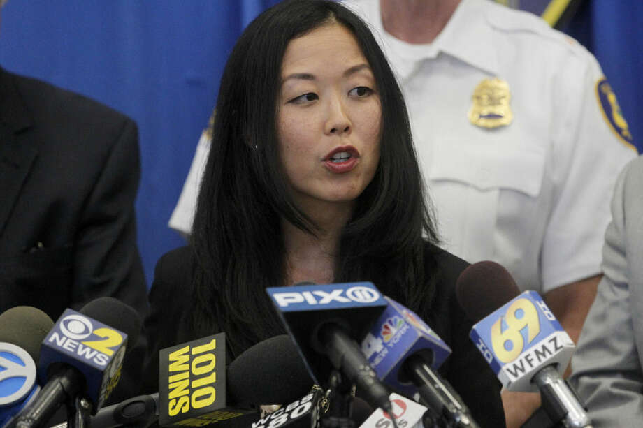Union County Prosecutor Grace Park announces that Todd West, from Elizabeth, has been charged with three homicides from June 25, 2015 and one homicide from May 18, 2015 during a news conference in Elizabeth, N.J., Thursday, July 9, 2015. (Ed Murray/The Star-Ledger via AP) MANDATORY CREDIT TV OUT, MAGS OUT, INTERNET OUT, NO SALES, NO ARCHIVING