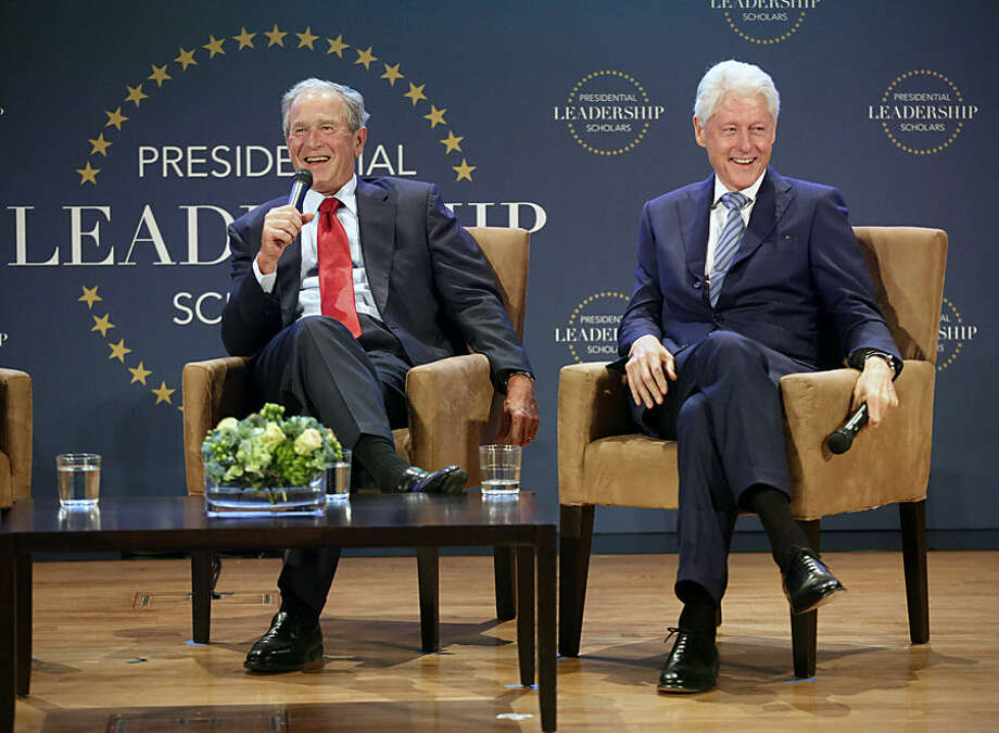 Former President George W. Bush, left, and former President Bill Clinton share a laugh during the Presidential Leadership Scholars Graduation at the George W. Bush Presidential Center in University Park, Texas, Thursday, July 9, 2015. Sixty scholars participated in the yearlong program where they traveled to each of the presidential libraries. (Tom Fox/The Dallas Morning News via AP) MANDATORY CREDIT; MAGS OUT; TV OUT; INTERNET USE BY AP MEMBERS ONLY; NO SALES