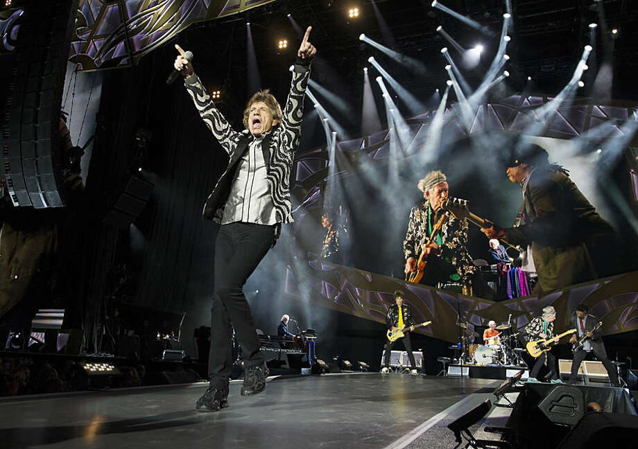 Mick Jagger and the Rolling Stones, perform at Comerica Park, Wednesday, July 8, 2015, in Detroit. (Daniel Mears/Detroit News via AP) DETROIT FREE PRESS OUT; HUFFINGTON POST OUT; MANDATORY CREDIT