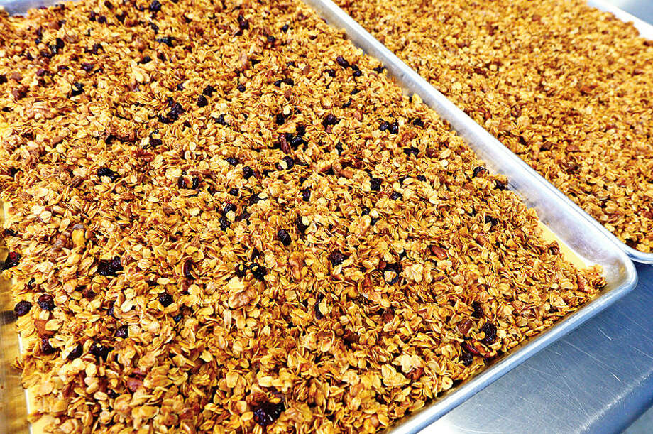 Hour photo / Erik Trautmann The Kelly family has been manufacturing Kelly Plus Four Granola in Norwalk for the past 3 years.
