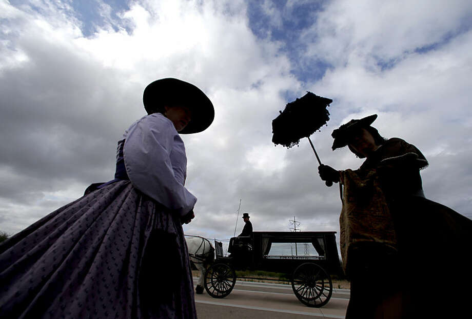 Civil War re-enactors wait near a horse-drawn hearse used to transport the remains of Army Sgt. Charles Schroeter, Thursday, July 9, 2015, in San Diego, Calif. Schroeter, who was awarded the Congressional Medal of Honor for gallantry in an 1869 battle during the Indian Wars, will be re-interred with full military honors at Miramar National Cemetery in San Diego. Schroeter's remains were located recently when the Congressional Medal of Honor Historical Society traced them to Greenwood Memorial Park in San Diego. (AP Photo/Chris Carlson)