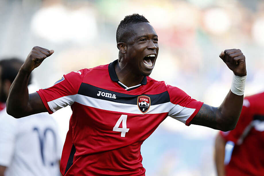 Trinidad and Tobago defender Sheldon Bateau celebrates his goal against Guatemala during the first half of a CONCACAF Gold Cup soccer match, Thursday, July 9, 2015, in Chicago. (AP Photo/Andrew A. Nelles)