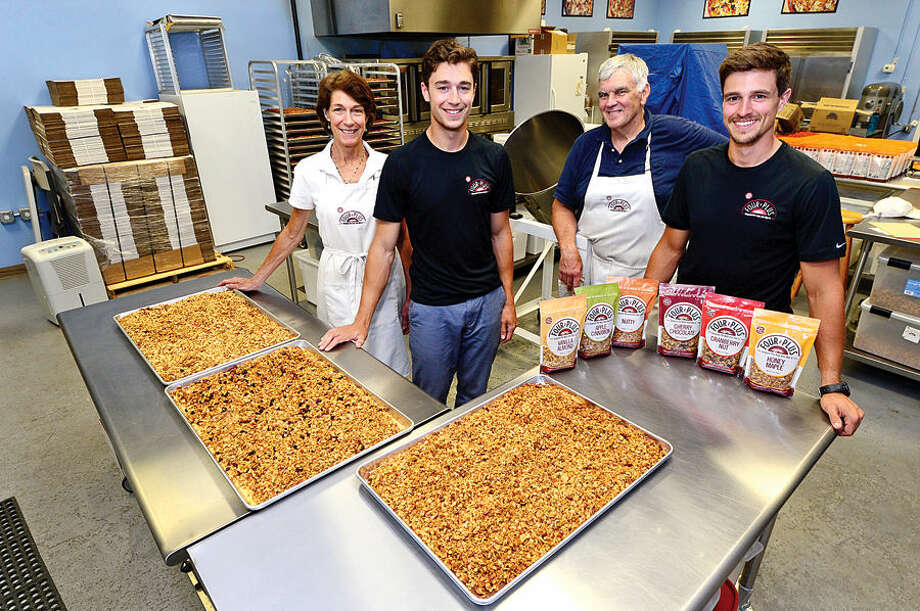 Hour photo / Erik Trautmann The Kelly family, Cordy, Will, Jimmy and Nate have been manufacturing Kelly Plus Four Granola in Norwalk for the past 3 years.