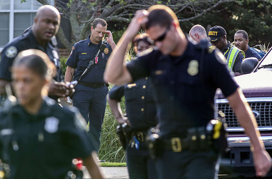 Police respond to the scene of a shooting, Thursday, July 9, 2015, in the East Lake neighborhood of Atlanta. Police say a 16-year-old girl was shot in the chest and killed in a bedroom of her family's apartment in The Villages of East Lake. (John Spink/Atlanta Journal-Constitution via AP)