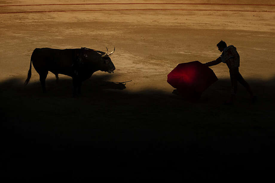 French bullfighter Sebastian Castella performs with a Victoriano del Rio ranch fighting bull during a bullfight of the San Fermin festival in Pamplona, Spain, Thursday, July 9, 2015. Revelers from around the world arrive in Pamplona every year to take part in some of the eight days of partying and the running of the bulls. (AP Photo/Daniel Ochoa de Olza)
