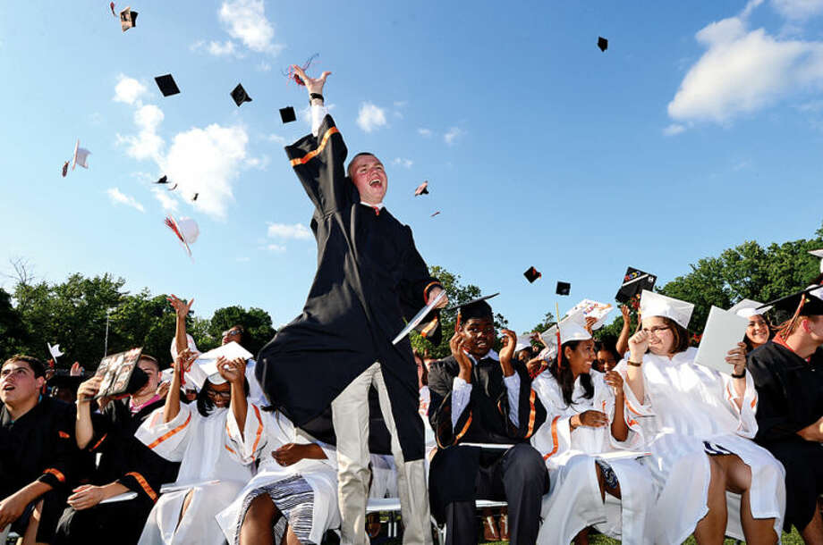 Hour photo / Erik Trautmann Stamford High School seniors including Will Smith celebrate the graduation of the Class of 2014 during commencement exercises Thursday afternoon at Boyle Stadium.