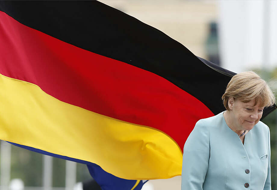 German Chancellor Angela Merkel arrives at Bosnian Parlament in Sarajevo, Bosnia, Thursday, July 9, 2015. Merkel is on a Balkan trip to Albania, Serbia and Bosnia, which are all looking to becoming European Union members one day.(AP Photo/Amel Emric)