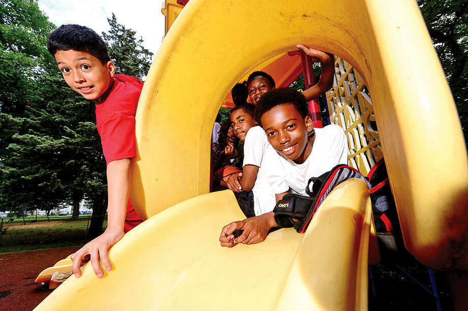 Hour photo / Erik Trautmann Alfredo Delcastillo, 11, and William Hinton, 12, enjoy their time at the Carver Community Center Tuesday during the Carver Foundation's summer camp.