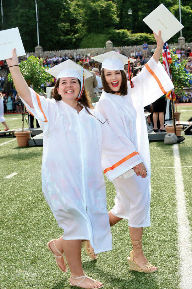 Hour photo / Erik Trautmann Stamford High School seniors including Brianna Bellavia and Daniella Malinowski celebrate the graduation of the Class of 2014 during commencement exercises Thursday afternoon at Boyle Stadium.