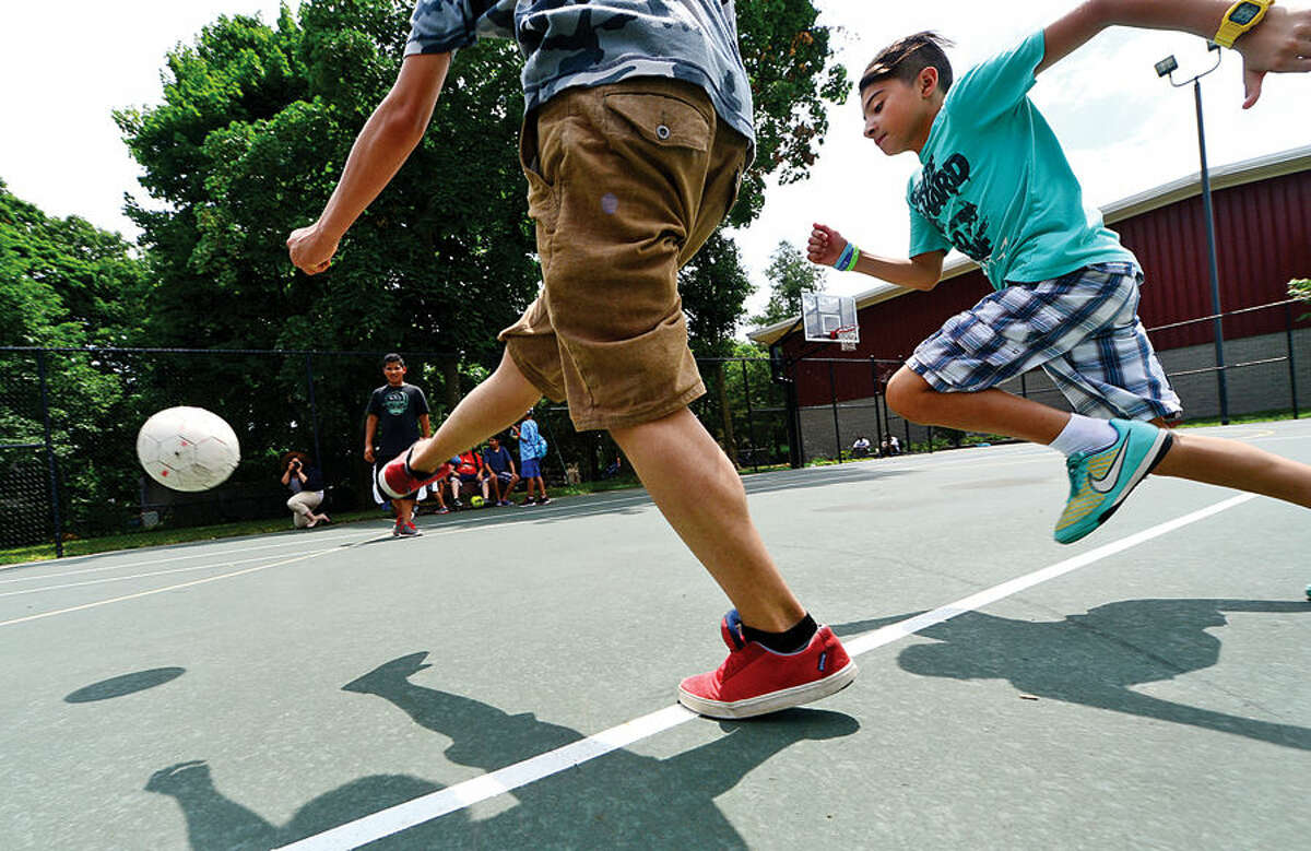 Keilor Falls, 12, plays soccer with friends at the Carver Community Center during the Carver Foundation's summer camp.