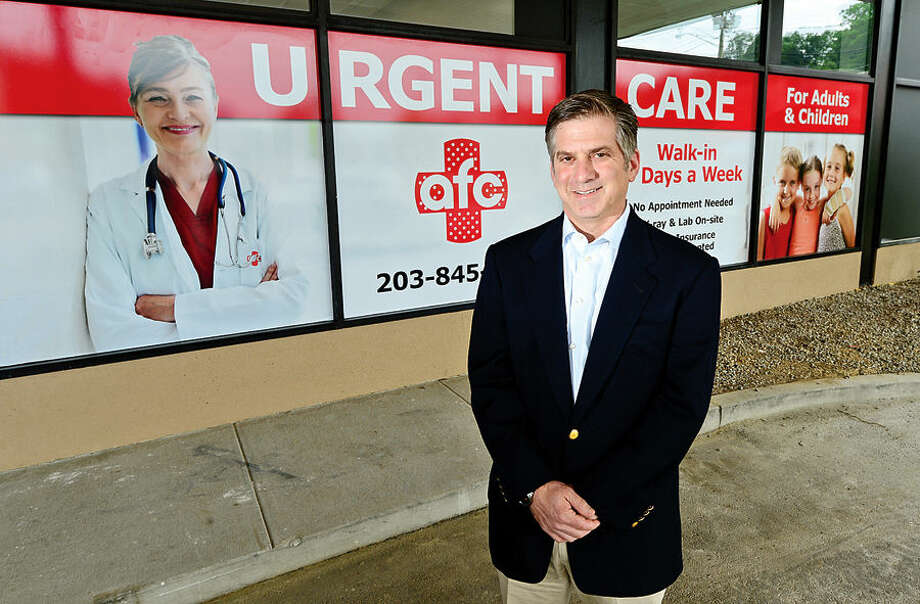 Hour photo / Erik Trautmann Owner Ken Goldberg prepares to open his new Urgent Care facility on Main Ave in Norwalk on July 23rd.