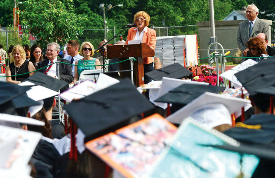 Hour photo / Erik Trautmann Superintendent of School Winifred Hamilton speaks to the Class of 2014 during the Stamford High School commencement exercises Thursday afternoon at Boyle Stadium.
