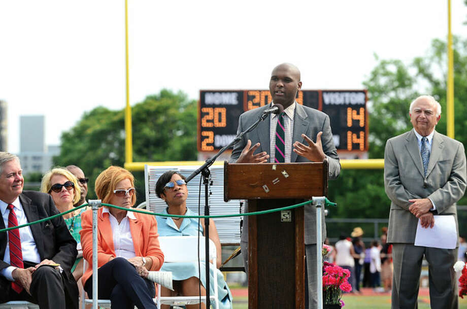 Hour photo / Erik Trautmann Channel 12 News' Brandon Walker speaks to the Class of 2014 during the Stamford High School commencement exercises Thursday afternoon at Boyle Stadium.