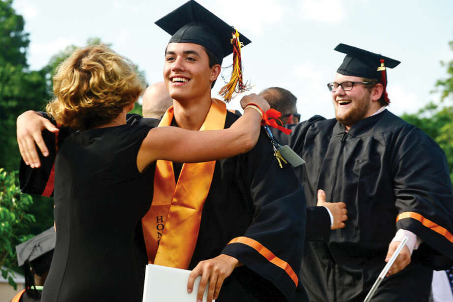 Hour photo / Erik Trautmann Stamford High School seniors including Michael Hoherchak celebrate the graduation of the Class of 2014 during commencement exercises Thursday afternoon at Boyle Stadium.
