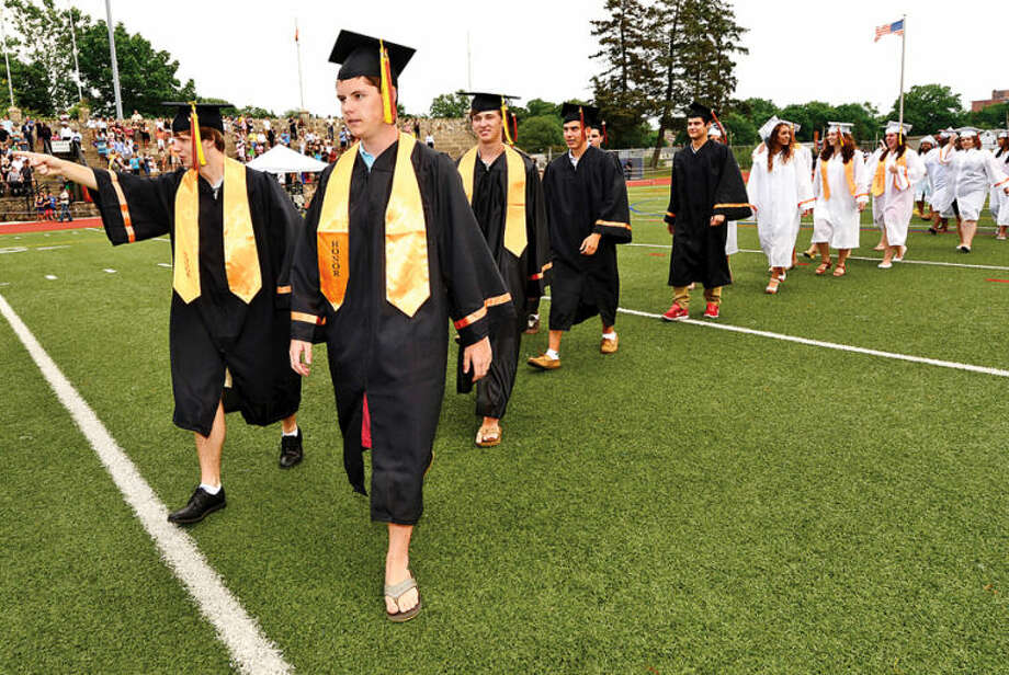 Hour photo / Erik Trautmann Stamford High School seniors celebrate the graduation of the Class of 2014 during commencement exercises Thursday afternoon at Boyle Stadium.