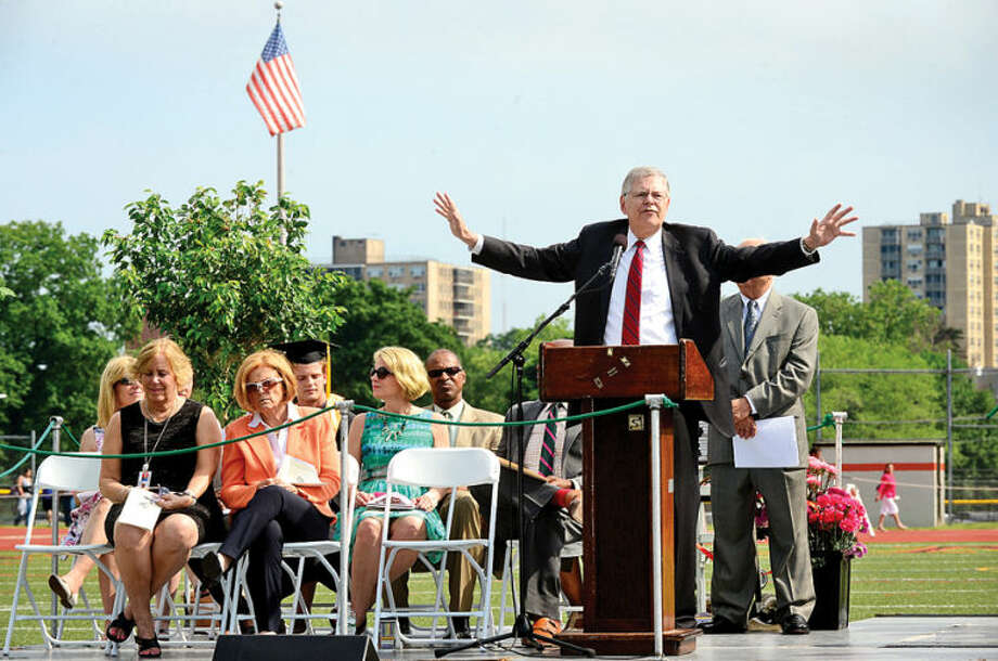 Hour photo / Erik Trautmann Mayor David Martin speaks to the Class of 2014 during the Stamford High School commencement exercises Thursday afternoon at Boyle Stadium.