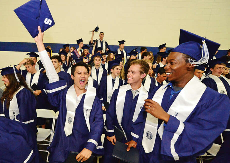 Hour photo / Erik Trautmann Staples High school seniors including Rick Daily, at left, celebrate the graduation of the Class of 2014 during commencement exercises in Westport Friday afternoon.