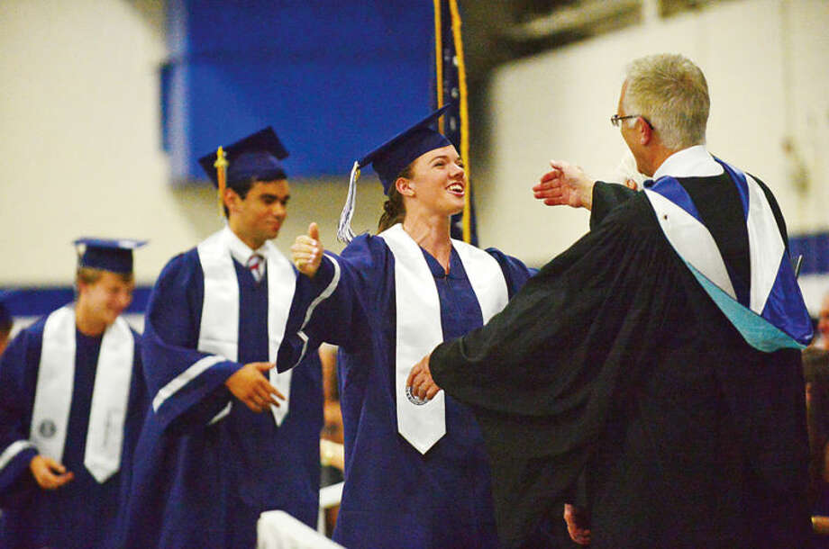 Hour photo / Erik Trautmann Staples High school seniors including Kelsey Shockey celebrate the graduation of the Class of 2014 during commencement exercises in Westport Friday afternoon.