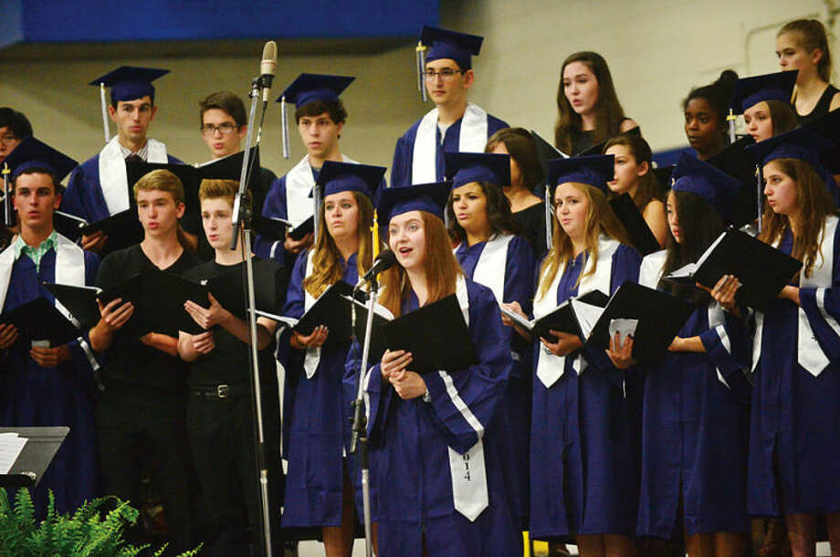 Hour photo / Erik Trautmann Staples High school Concert Choir sings Reap What You Sow to the Class of 2014 during commencement exercises in Westport Friday afternoon.