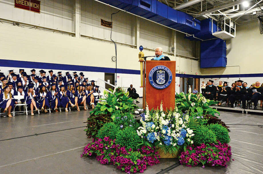 Hour photo / Erik Trautmann Westport Superintendent of Schools Dr. Elliot Landon addresses the Staples High School Class of 2014 during commencement exercises in Westport Friday afternoon.