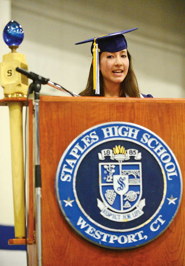 Hour photo / Erik Trautmann Staples High school valedictorian Eliza Llewellyn addresses the Class of 2014 during commencement exercises in Westport Friday afternoon.