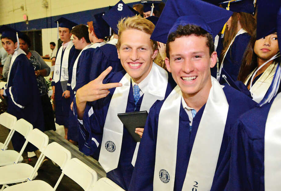 Hour photo / Erik Trautmann Staples High school senior celebrates the graduation of the Class of 2014 during commencement exercises in Westport Friday afternoon.