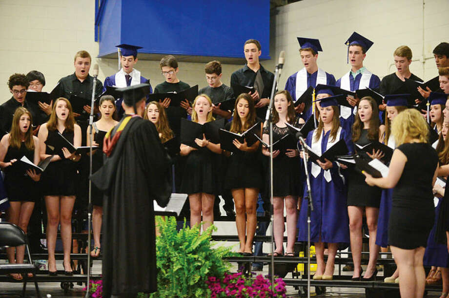 Hour photo / Erik Trautmann Staples High school choir sing The National Anthem for the Class of 2014 during commencement exercises in Westport Friday afternoon.