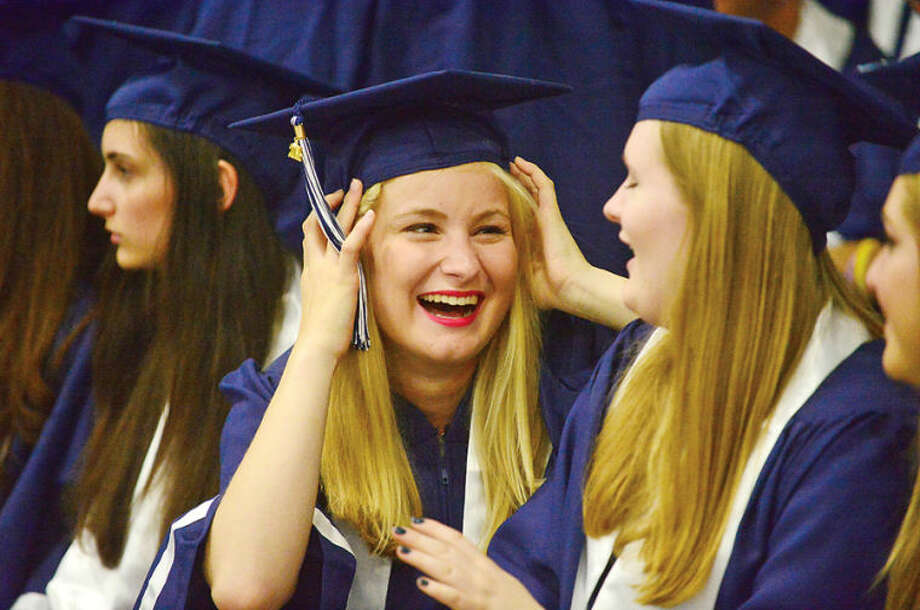 Hour photo / Erik Trautmann Staples High school seniors celebrate the graduation of the Class of 2014 during commencement exercises in Westport Friday afternoon.