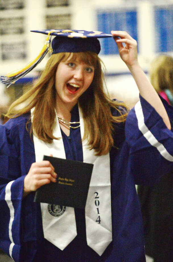 Hour photo / Erik Trautmann Staples High school seniors including Alison Thompson celebrate the graduation of the Class of 2014 during commencement exercises in Westport Friday afternoon.